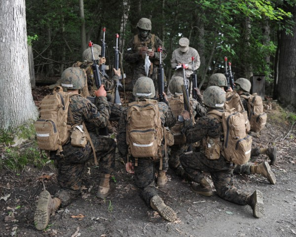 Candidate being evaluated on leadership at Marine OCS