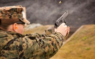 Female Marine Firing A Pistol