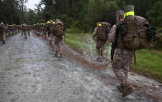 Marine on a hump through wet terrain